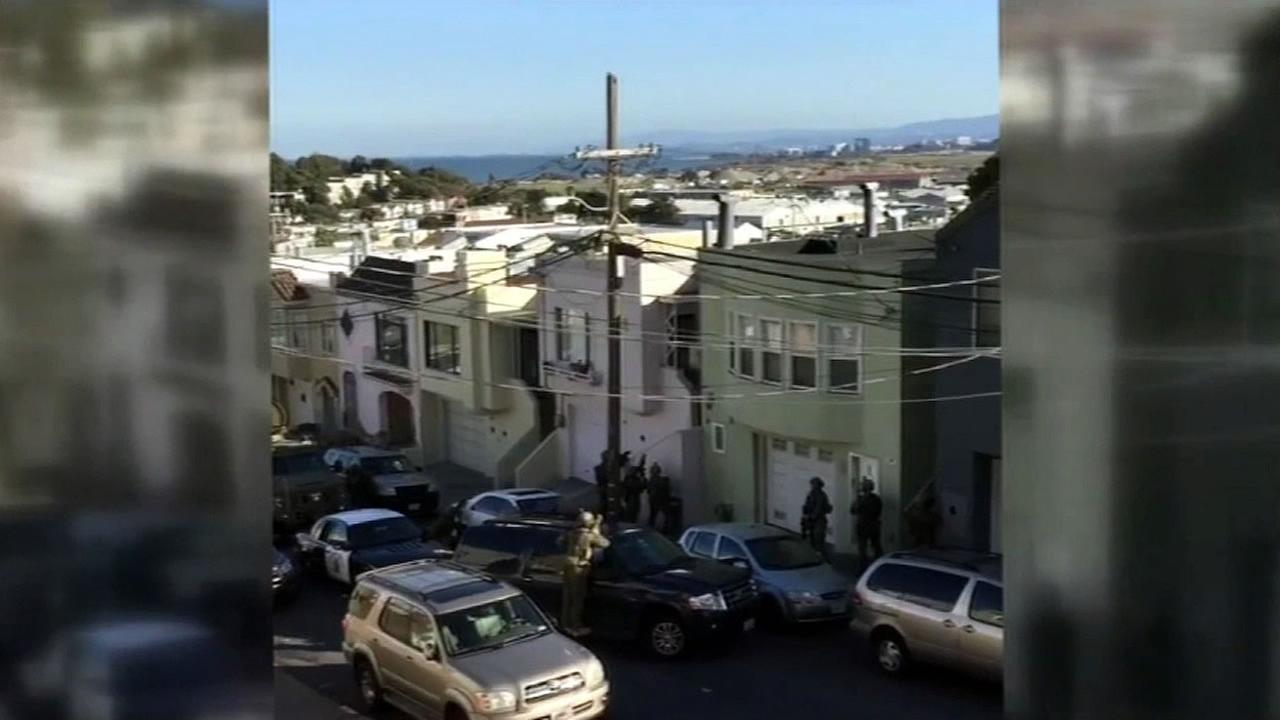 A raid at a home on Teddy Avenue in San Francisco, Calif. is seen on Friday, April 1, 2016.