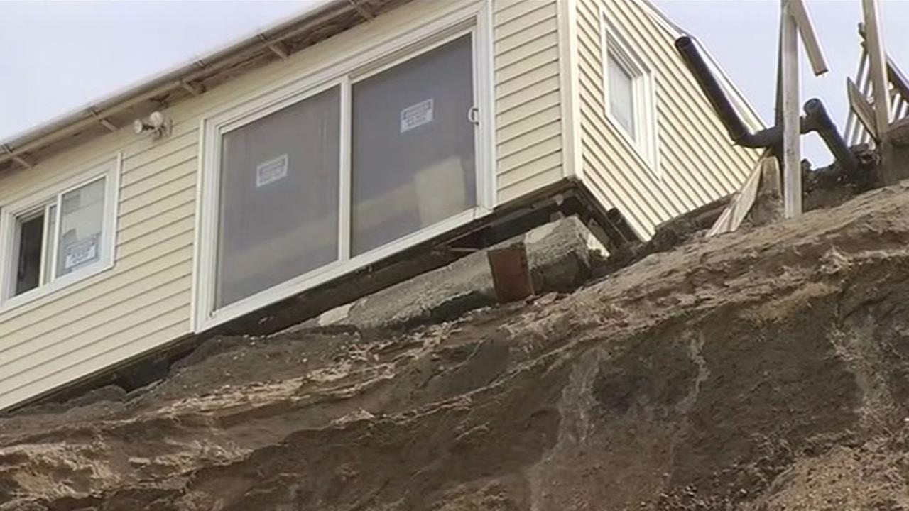 Crews work to move a house away from an eroding cliff in Pacifica, Calif. on Tuesday, April 19, 2016.