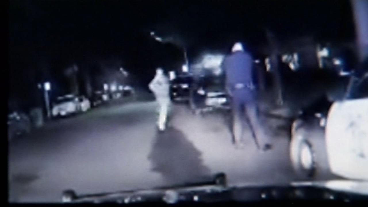This image is a still from video shot Christmas Day of a fatal officer-involved shooting in Palo Alto, Calif. of a man who was holding a butter knife.