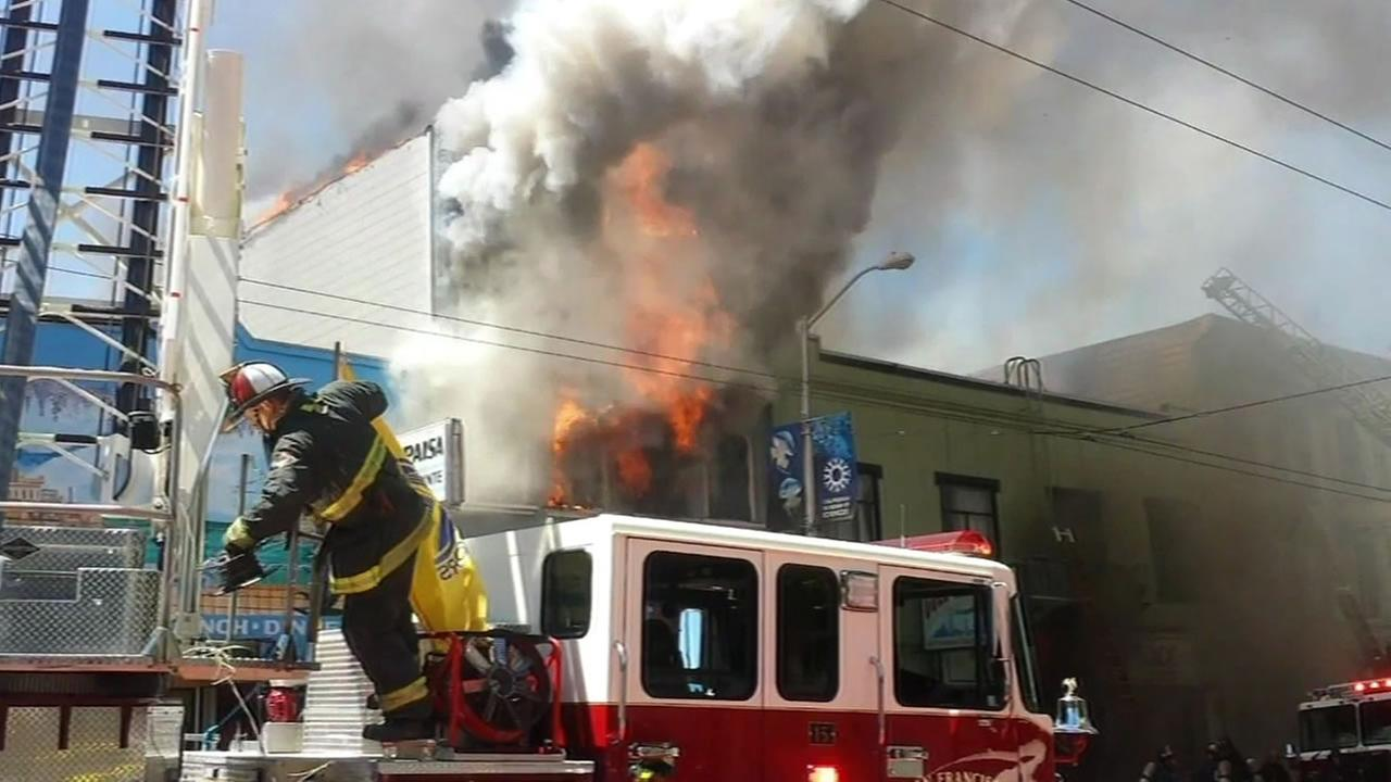 This image shows firefighters battling a five-alarm fire in San Franciscos Mission District on June 18, 2016.