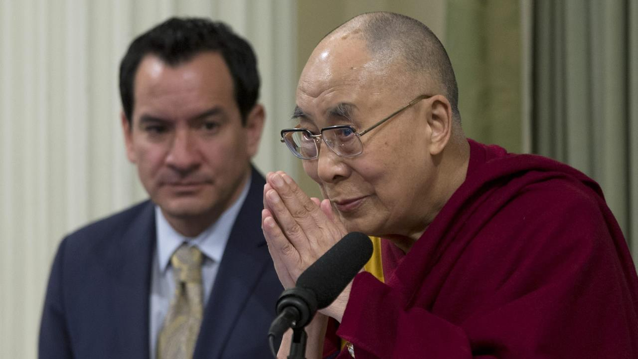 The Dalai Lama bows before speaking at a joint session of the California Legislature, Monday, June 20, 2016, in Sacramento, Calif.