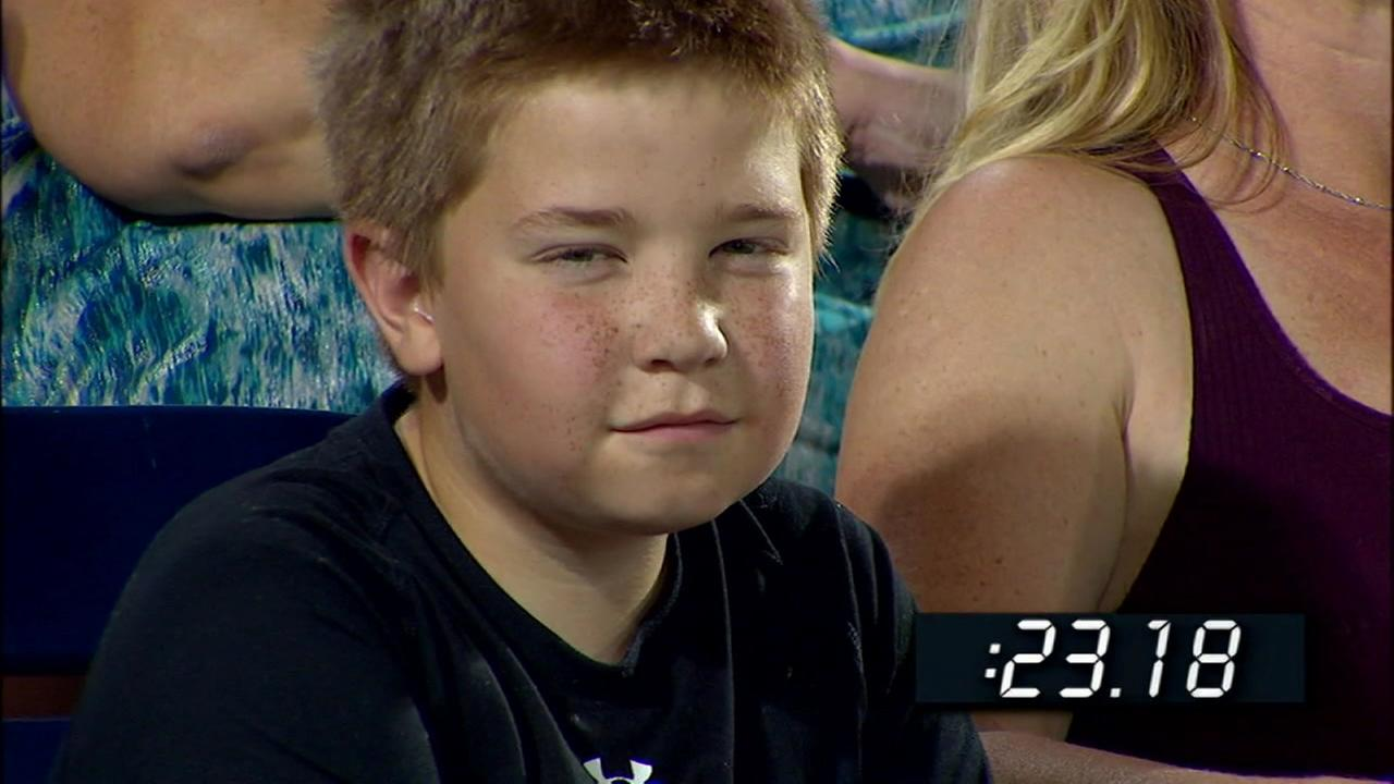 A young baseball fan gave an ESPN camera an epic stare-down at the mens college baseball championship game in Omaha, Neb. on June 24, 2016.