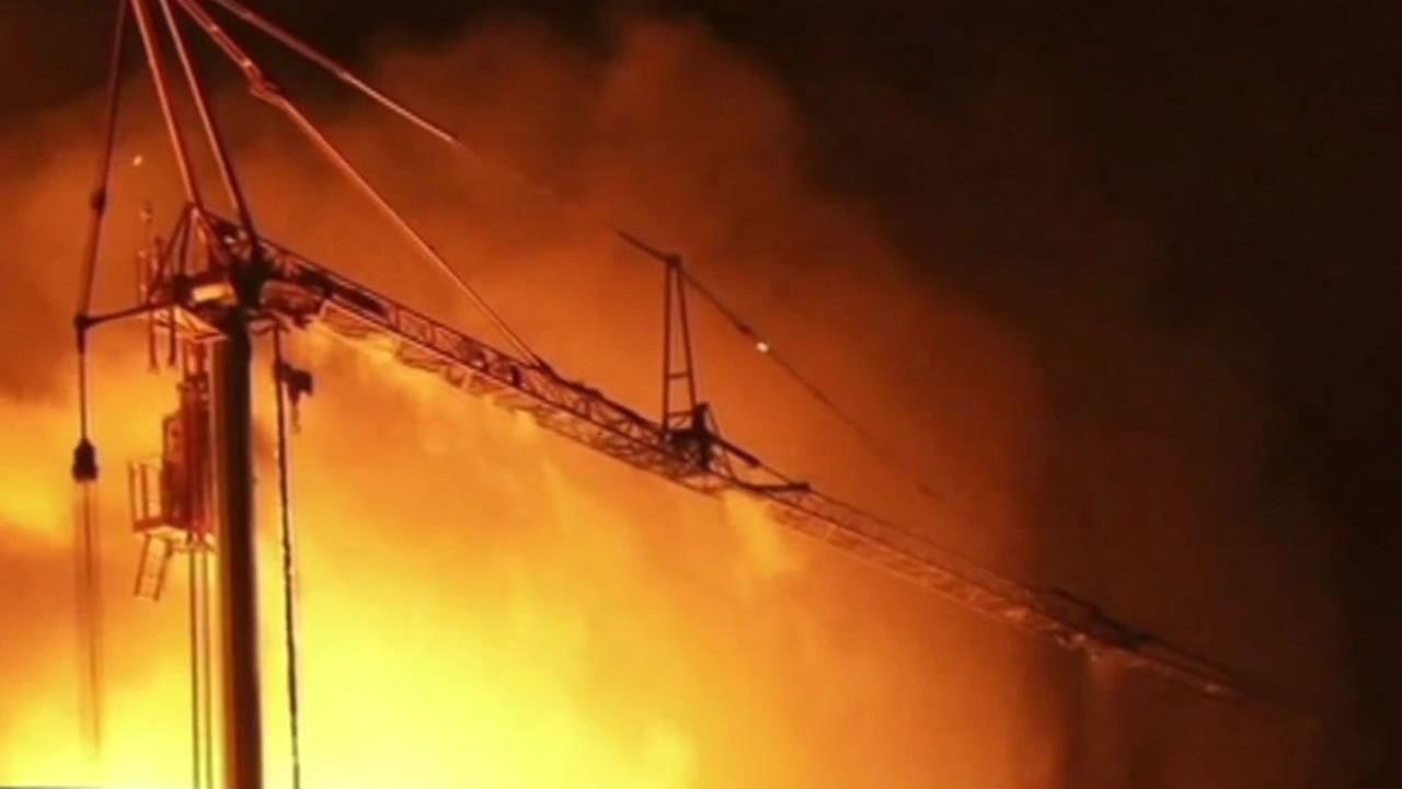 This image shows a crane that was being dismantled after it began to melt in a 6-alarm fire in Emeryville, Calif. on July 6, 2016.