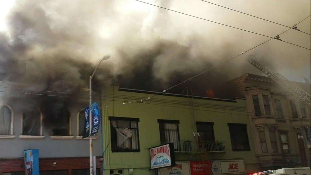 This image shows heavy smoke pouring out of a building on Mission and 29th streets in San Francisco on June 18, 2016.