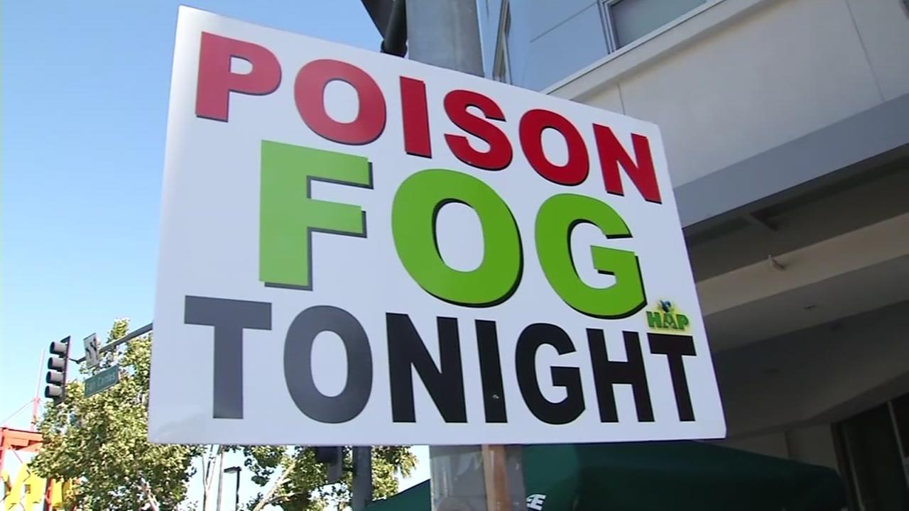 Someone holds up a sign fighting against fogging at a San Jose neighborhood on Wednesday, July 14, 2016.
