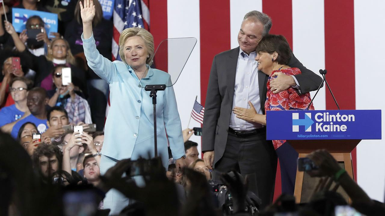 Sen. Tim Kaine, D-Va., hugs his wife Anne Holton during a with Democratic presidential candidate Hillary Clinton at Florida International University Panther Arena in Miami, Saturda