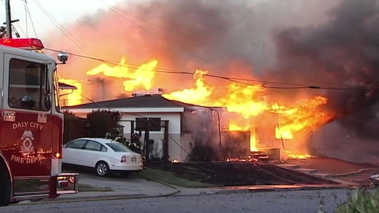 FILE- The image shows fire from an explosion in San Bruno, Calif. in 2010.