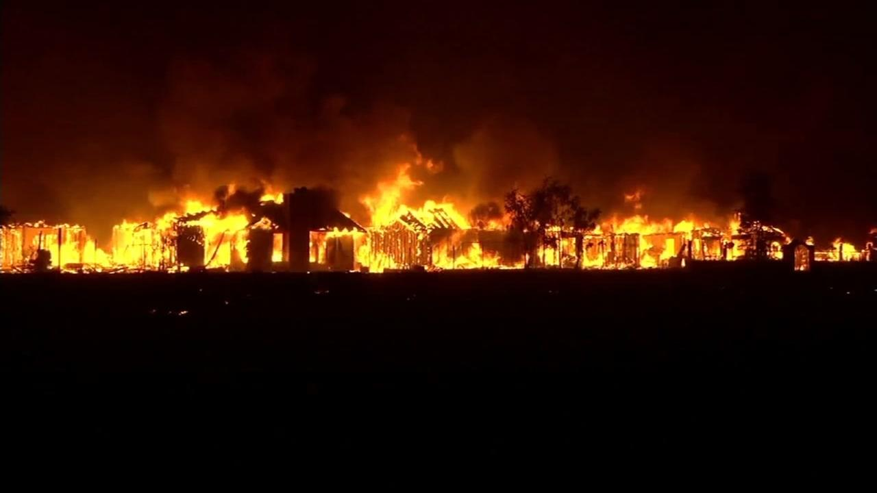 Massive Valley Fire burns structures in this undated image.