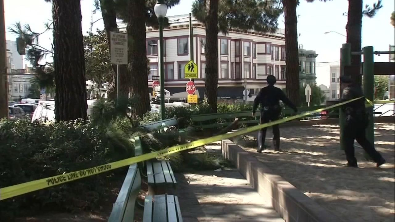 Crime scene tape and officers are seen at Washington Square Park in San Francisco, Calif.  on Friday, August 12, 2016.