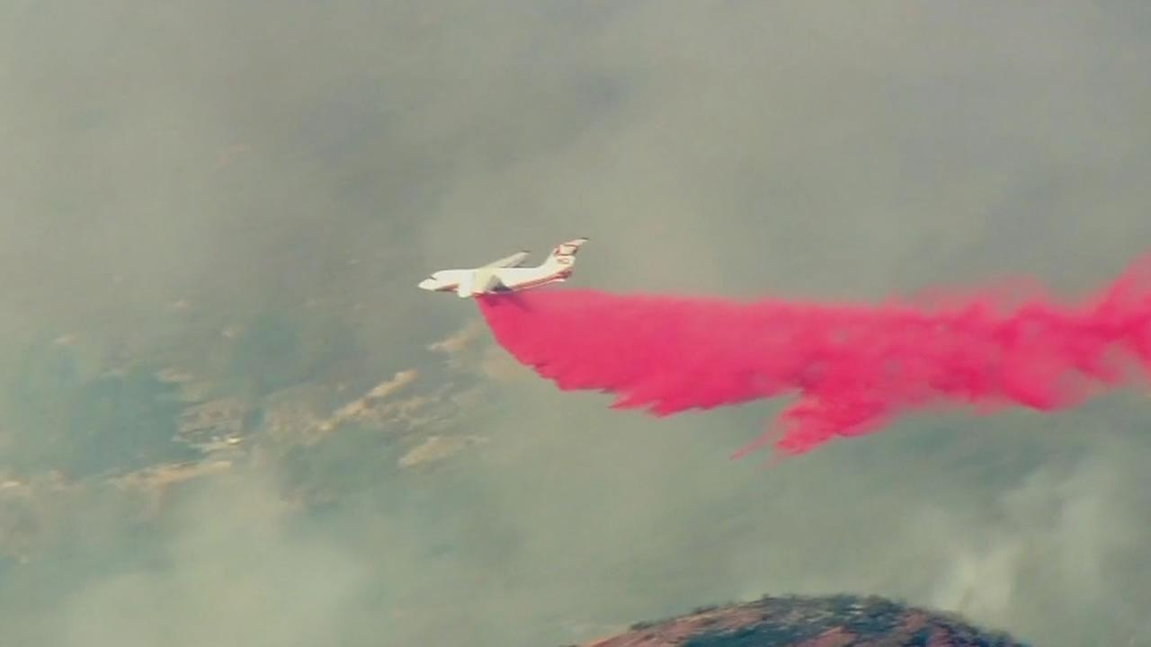 This image hows Cal Fire pilots dropping fire retardant on the Clayton Fire in Lake County, Calif.