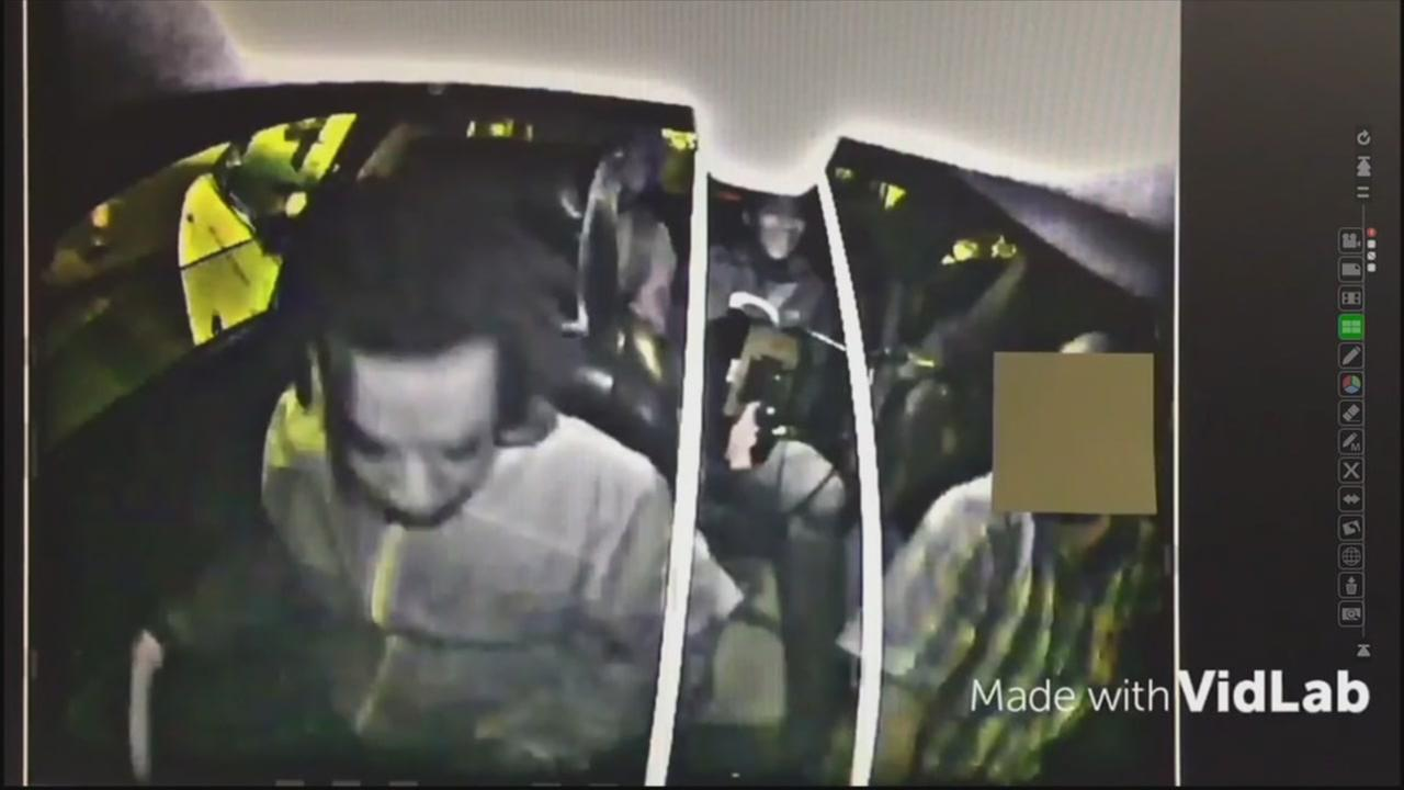 This image shows dashcam footage of a the robbery of a cab driver in San Francisco.