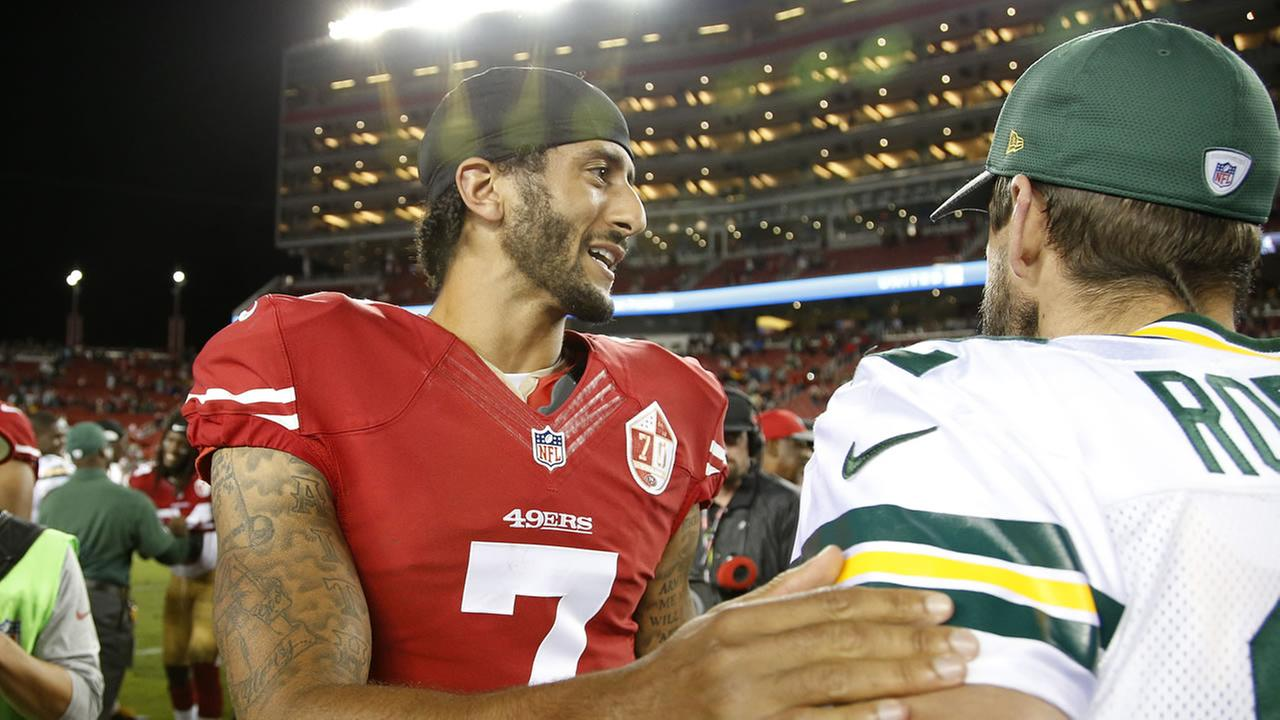 San Francisco 49ers quarterback Colin Kaepernick, left, greets Green Bay Packers quarterback Aaron Rodgers at the end of an preseason football game Aug. 26, 2016, in Santa Clara.