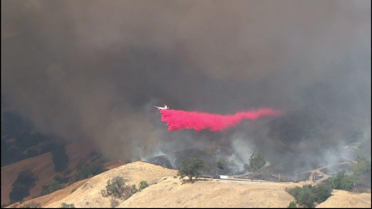 A wildfire burns near Cloverdale, Calif. on Sunday, September 25, 2016.