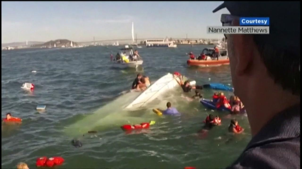 This image shows San Francisco firefighters responding to a rescue near Pier 45 after a boat with about 30 people on board capsized in the Bay on Saturday, October 8, 2016.