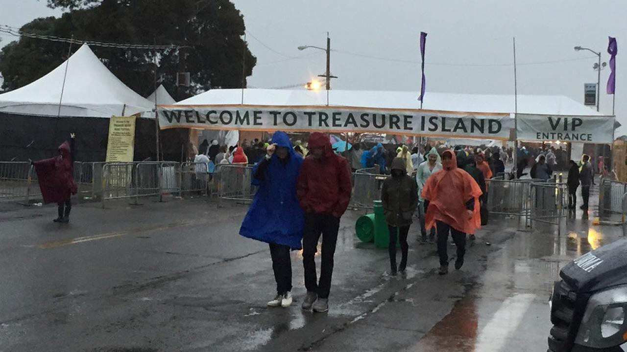 Music fans dodged the stormy weather Saturday Oct. 15, 2016 at the Treasure Island Music Festival.