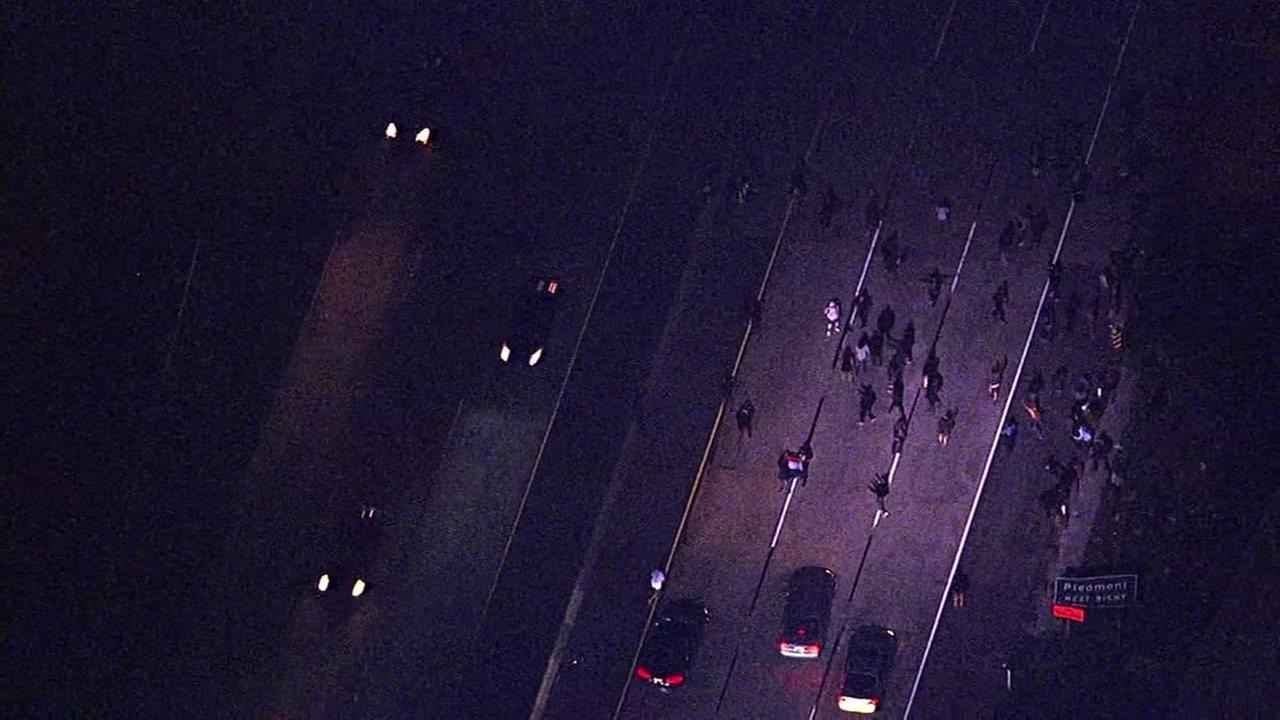 This image shows protesters marching onto Interstate 580 in Oakland, Calif, and shutting down lanes in both directions.