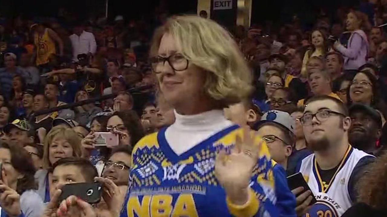 Golden State Warriors super fan Robin Schreiber dances at Oracle Arena, Oakland, California, Sunday, November 13, 2016.