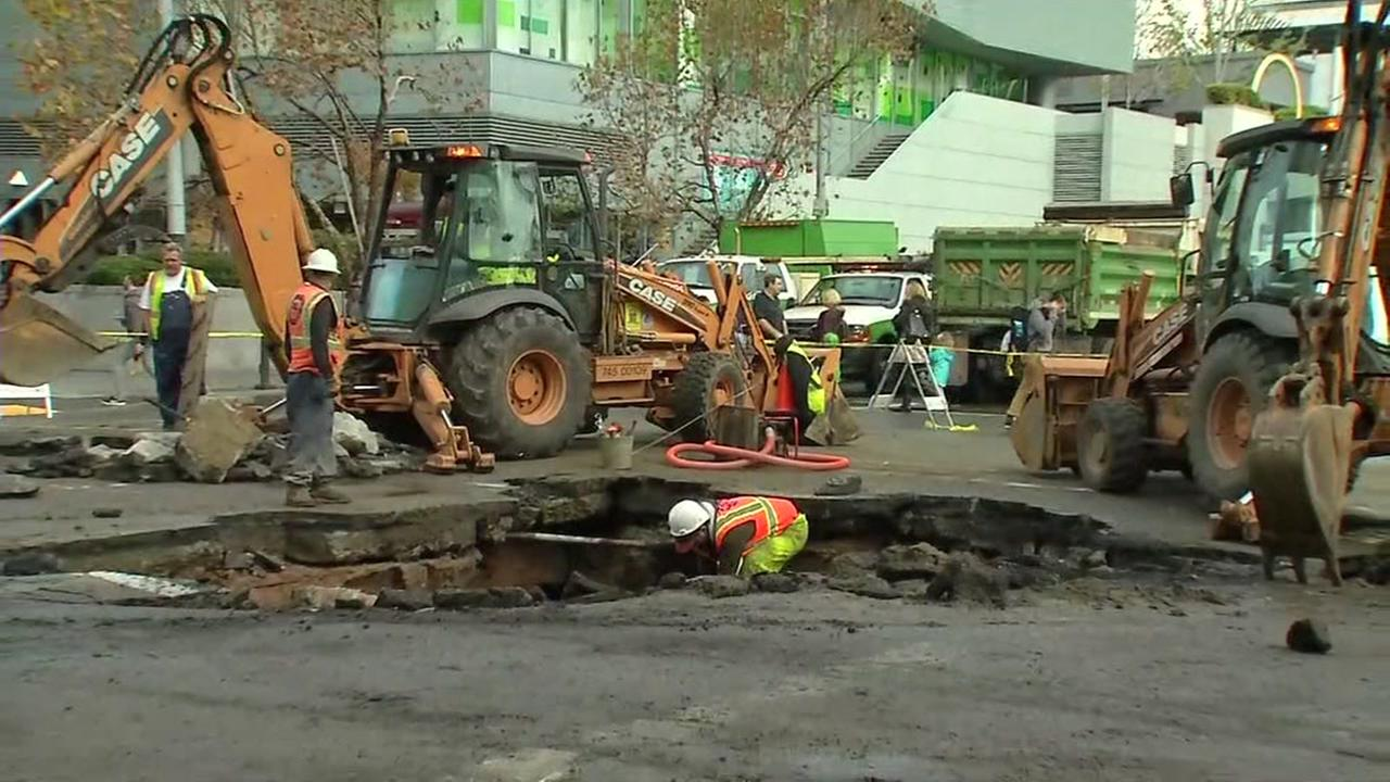 Crews repair a water main break at 4th and Howard streets near the Moscone Center in San Francisco on Friday, December 9, 2016.