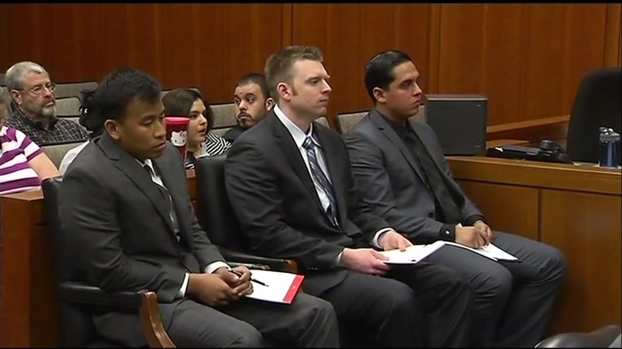 Three guards accused of killing a mentally ill inmate sit in a Santa Clara County court room.