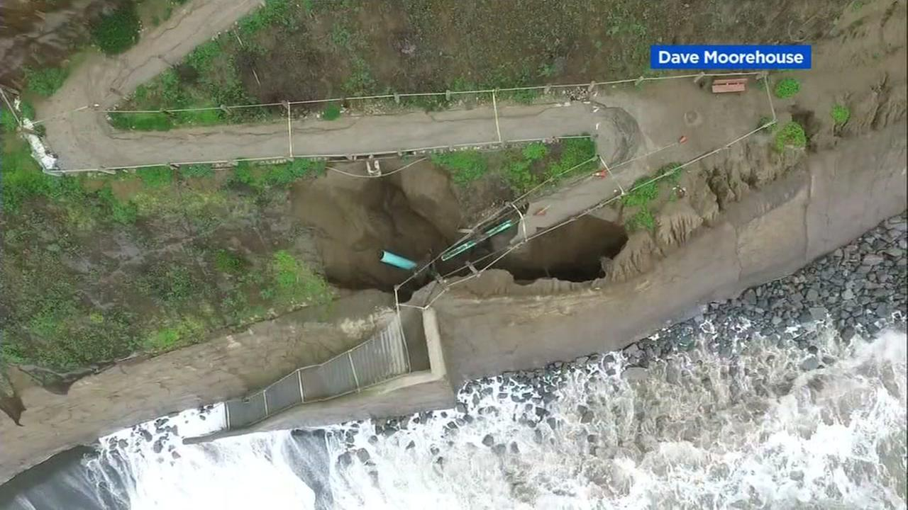 A sinkhole is seen at a beach in Pacifica, Calif. on Friday, December 9, 2016.