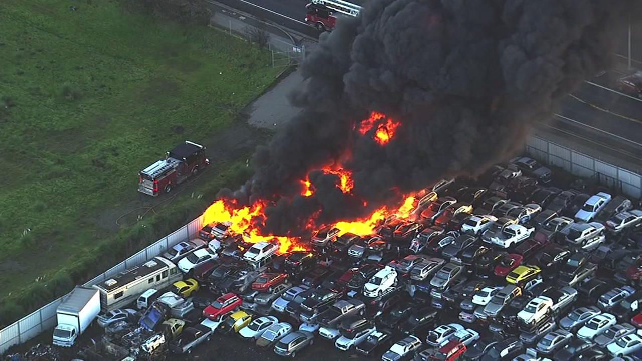 Cars went up in flames as a massive fire consumed an auto wrecking yard in Richmond, Calif. on Friday, Dec. 16, 2016.