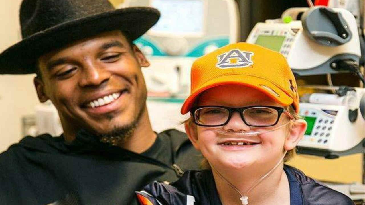Cam Newton is seen inside an Atlanta Hospital granting a Christmas wish for a young Auburn fan with a severe heart condition on Tuesday Dec. 27, 2016.