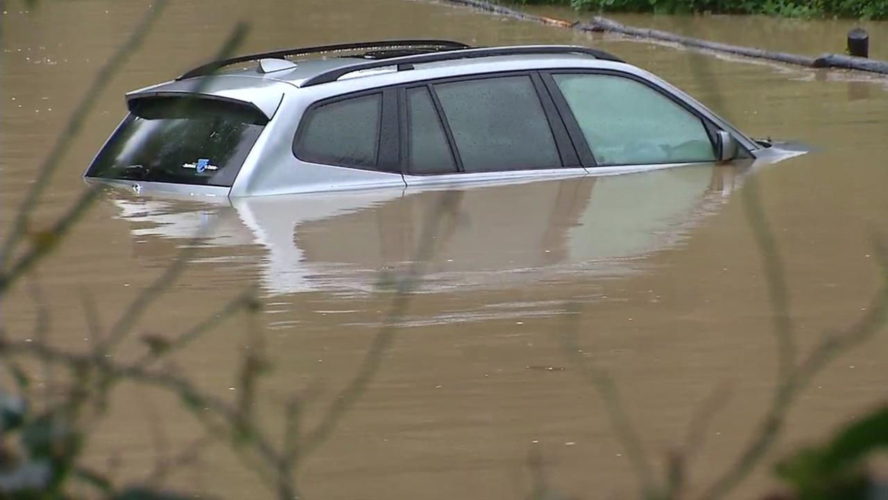 A car is seen submerged in water in Guerneville, Calif. on Monday, January 9, 2017 after a major storm swept through the area.