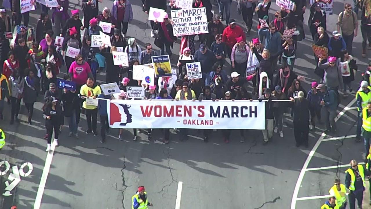 A large crowd walks through downtown Oakland, Calif. for the Womens March on Saturday, January 21, 2017.