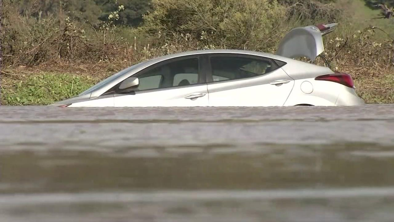 A car is seen underwater after it got stuck in flooding off of Highway 37 in Novato on Saturday, January 21, 2017.