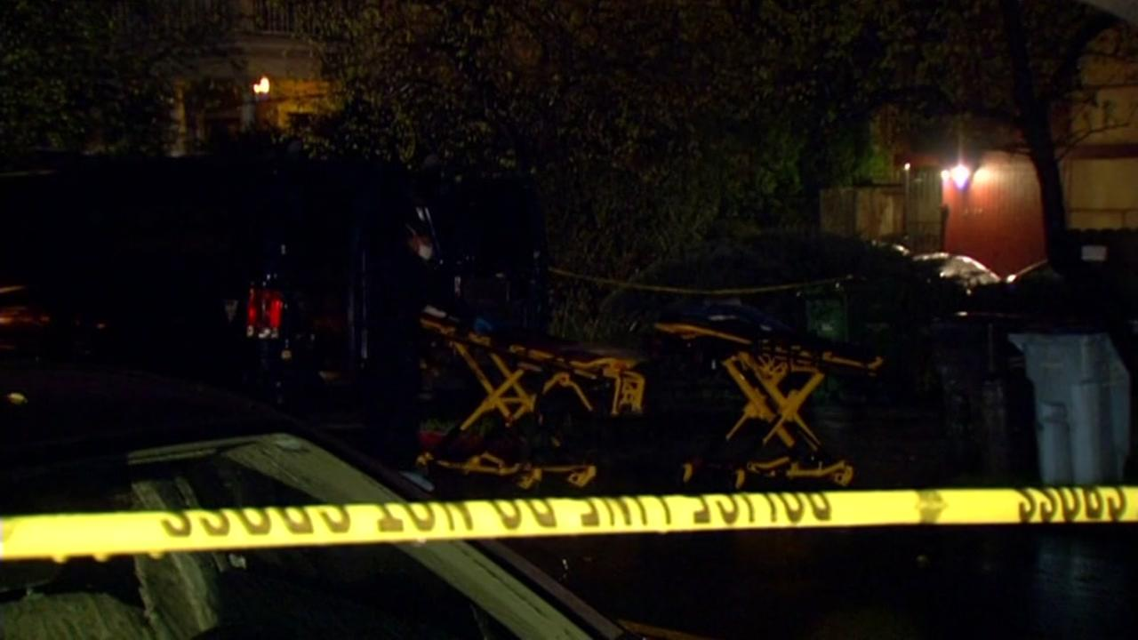 First responders tend to two stretchers outside of a home where two people and two cats were found dead in Berkeley, Calif. on Jan. 23, 2017.