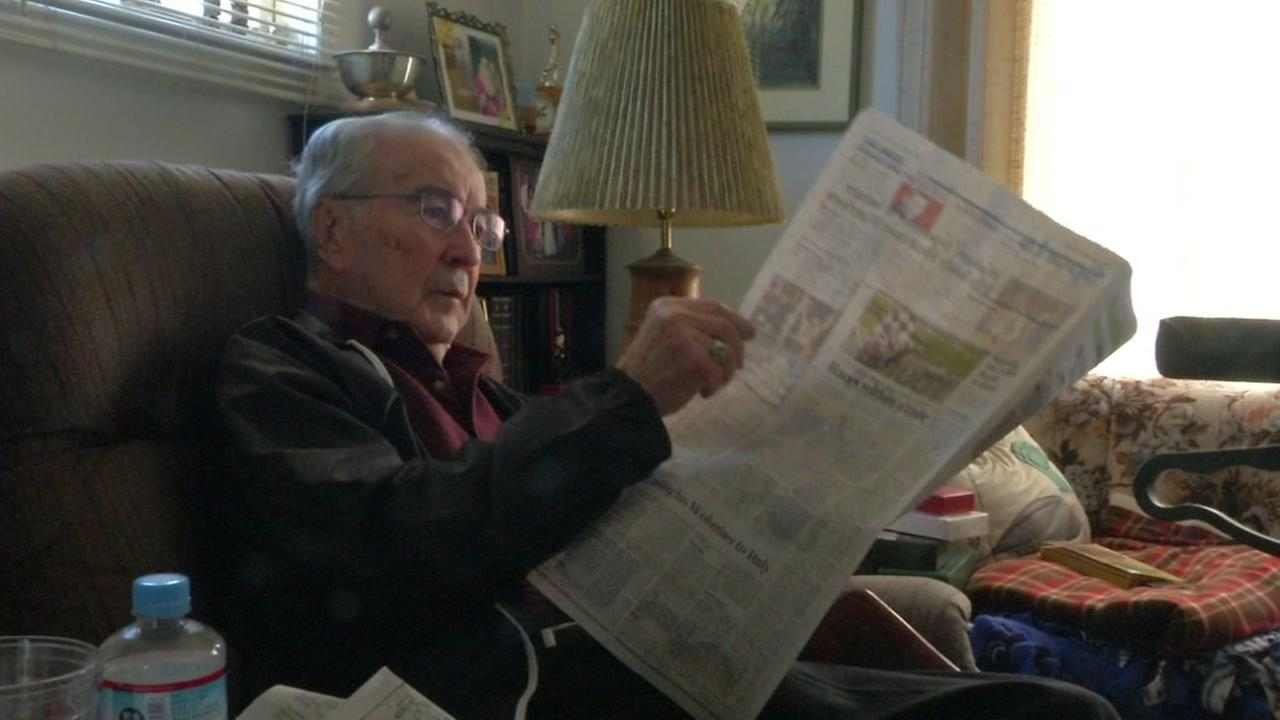 Selbie is seen reading a newspaper at a home in Richmond, Calif. in this undated image.