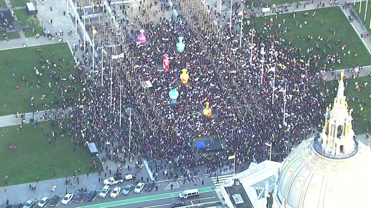 A large crowd is seen gathering in Civic Center Plaza in San Francisco on Saturday February 4, 2017.