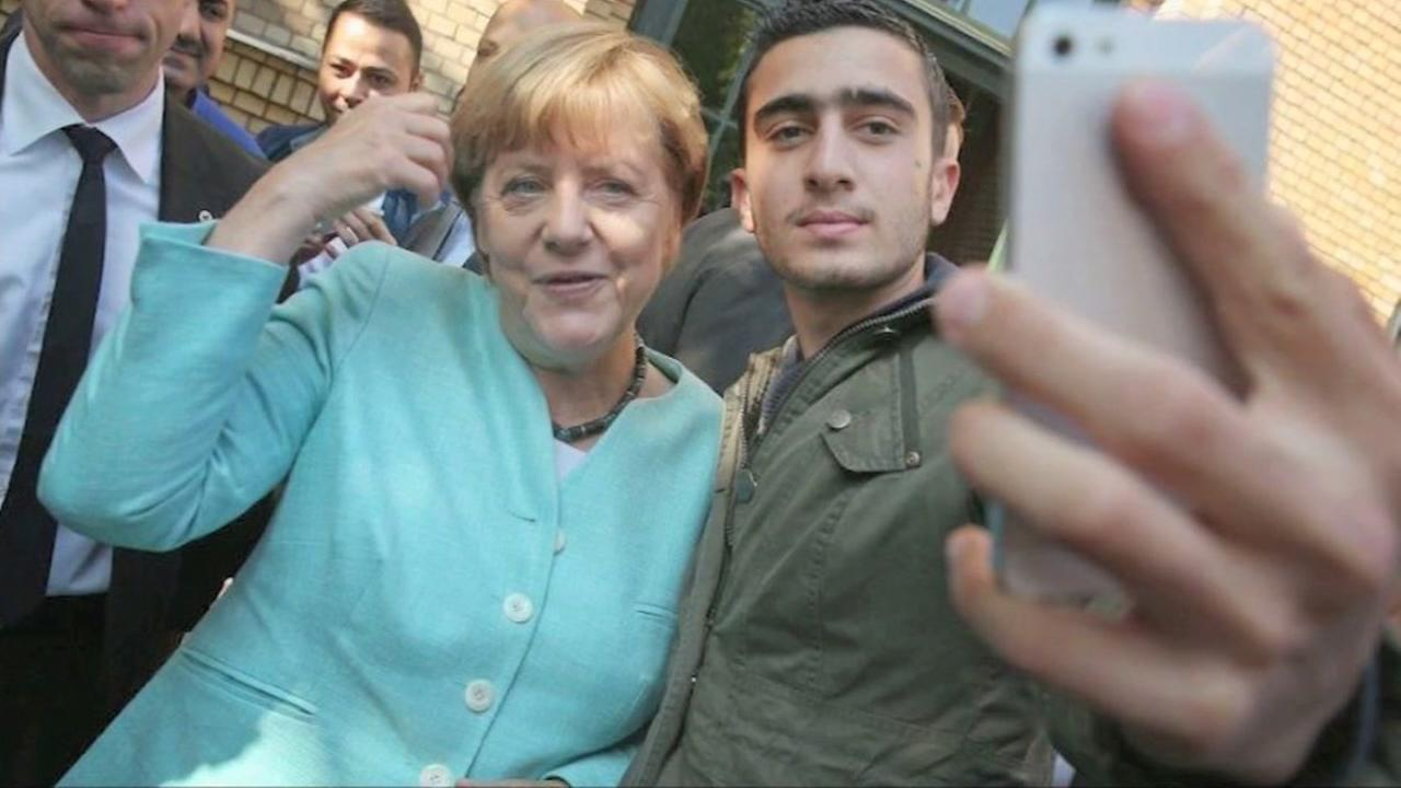 Angela Merkel, right, poses for a selfie with Anas Modamani in Germany.