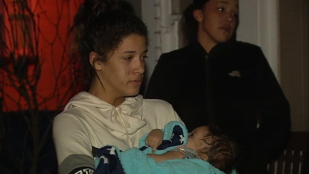 Leilani Millard holds her infant in San Leandro, Calif. on Feb. 14, 2017.