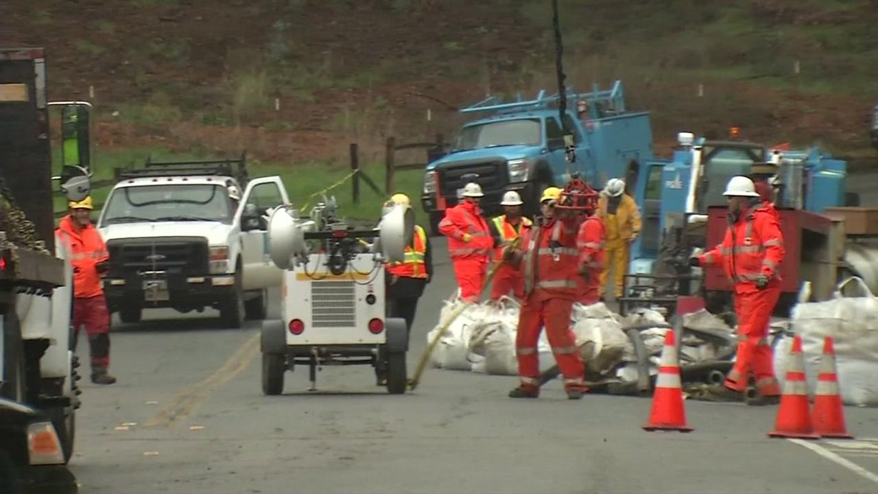 PG&E crews work to shore up a mudslide thats threatening power lines in Orinda, Calif. on Feb. 19, 2017.