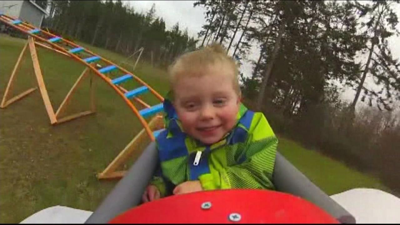 Dad builds backyard roller coaster to help bond with son