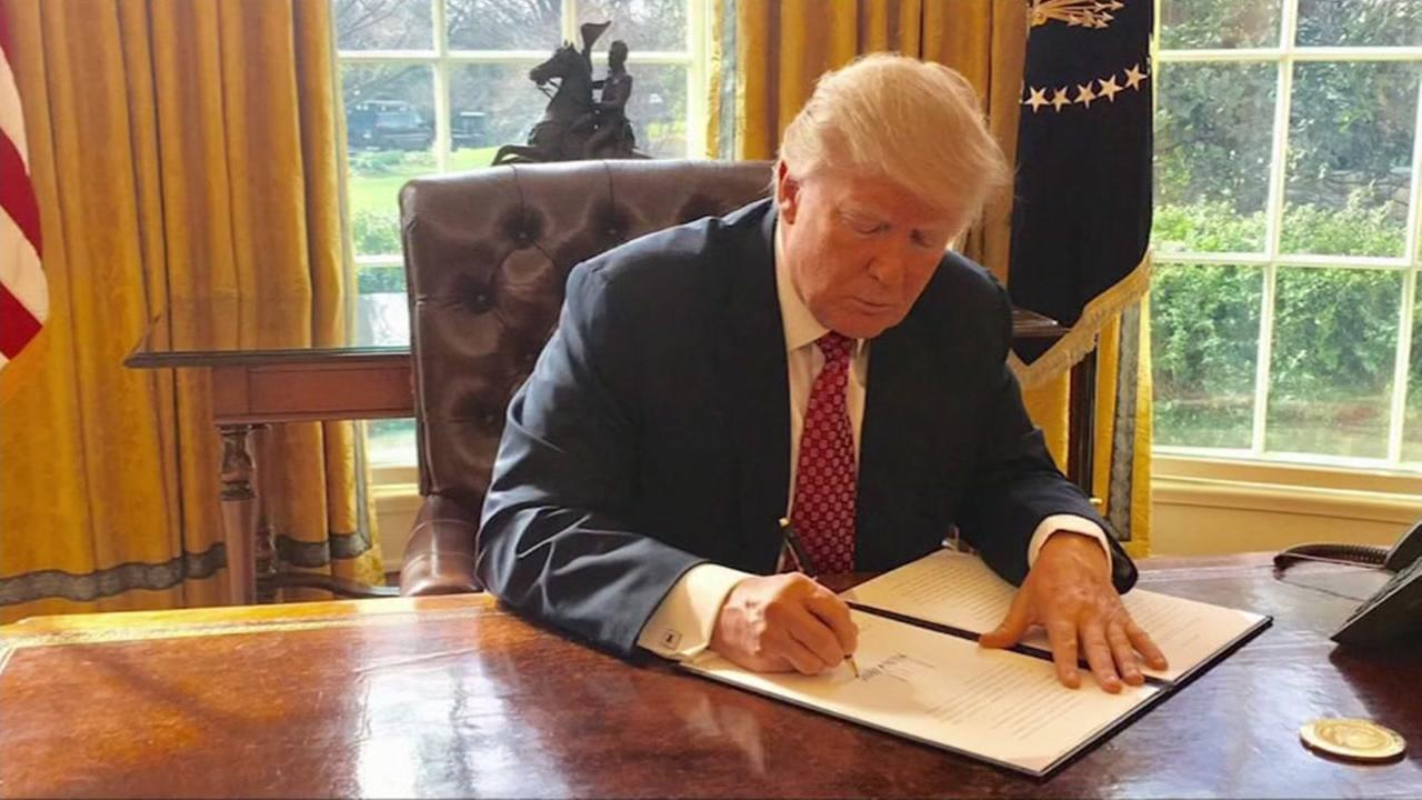 President Trump signs revised executive order on temporary travel ban