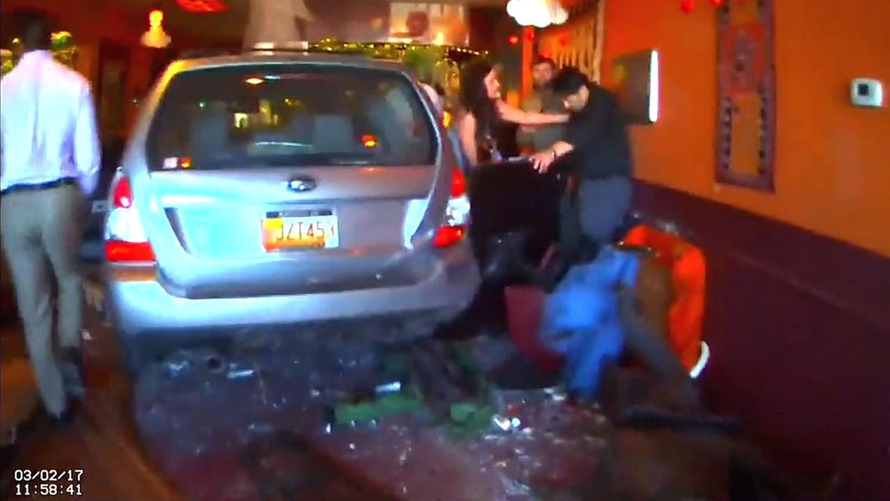 Police body cam video shows moments after a car crashed into a cafe in New Mexico on Thursday, March 2, 2017.