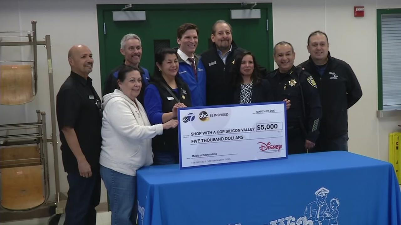 ABC7s Matt Keller is seen with Shop with a Cop Foundation of Silicon Valley at Santee Elementary School in San Jose, Calif. on Wednesday, March 22, 2017.