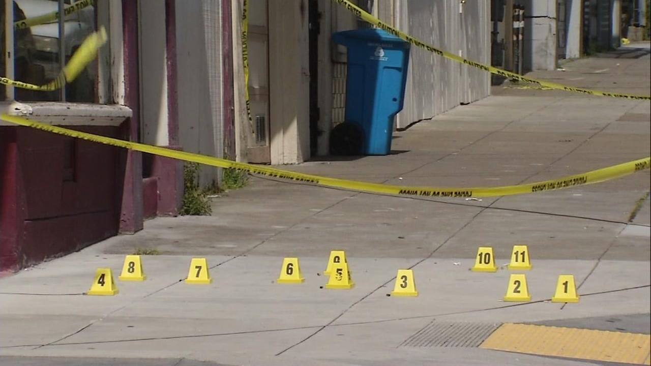 Evidence markers are seen on a San Francisco street after a shooting on Wednesday March 29, 2017.
