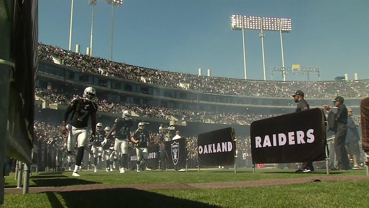 The Oakland Raiders are seen running onto the field at the Coliseum in this undated image.