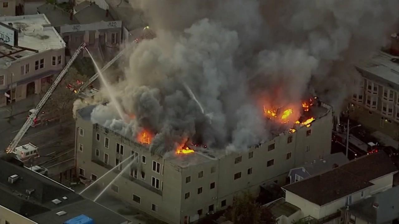 Smoke and flames engulf a building in Oakland, Calif. on Monday, March 27, 2017.