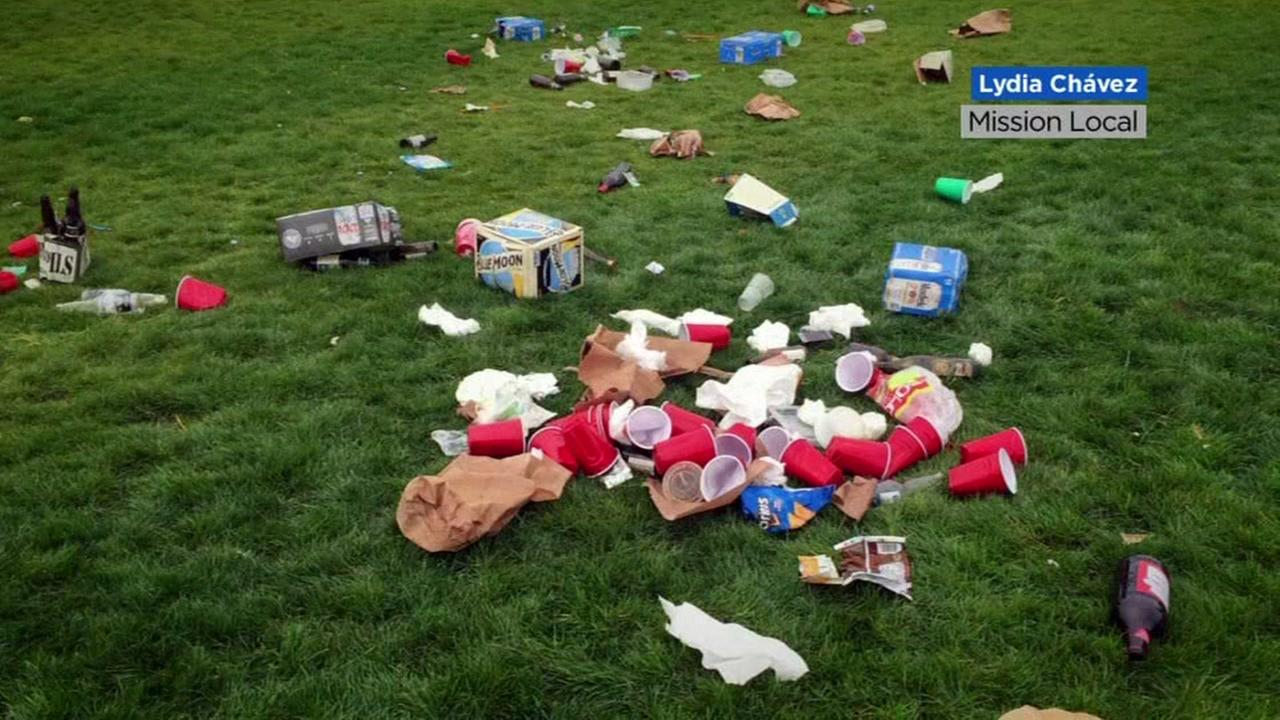 In this photo, trash is seen on grass at Dolores Park in San Francisco, Calif. on Saturday, April 1, 2017.