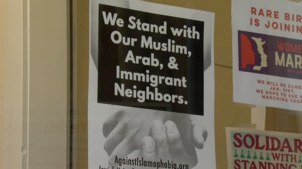 A sign supporting immigrants and Muslims appears outside a restaurant in Oakland, Calif. on Monday, March 3, 2017.