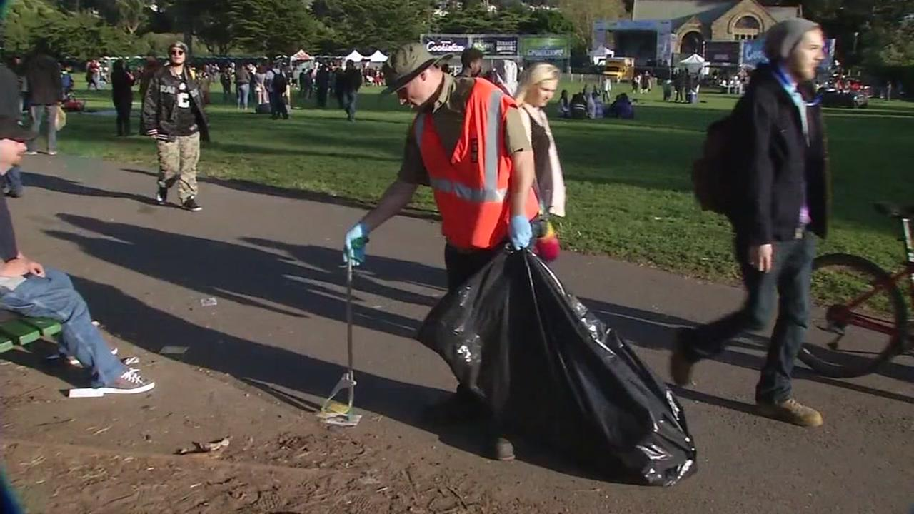 A city worker picks up garbage after the 4/20 celebration in San Franciscos Golden Gate Park on Thursday, April 20, 1017.