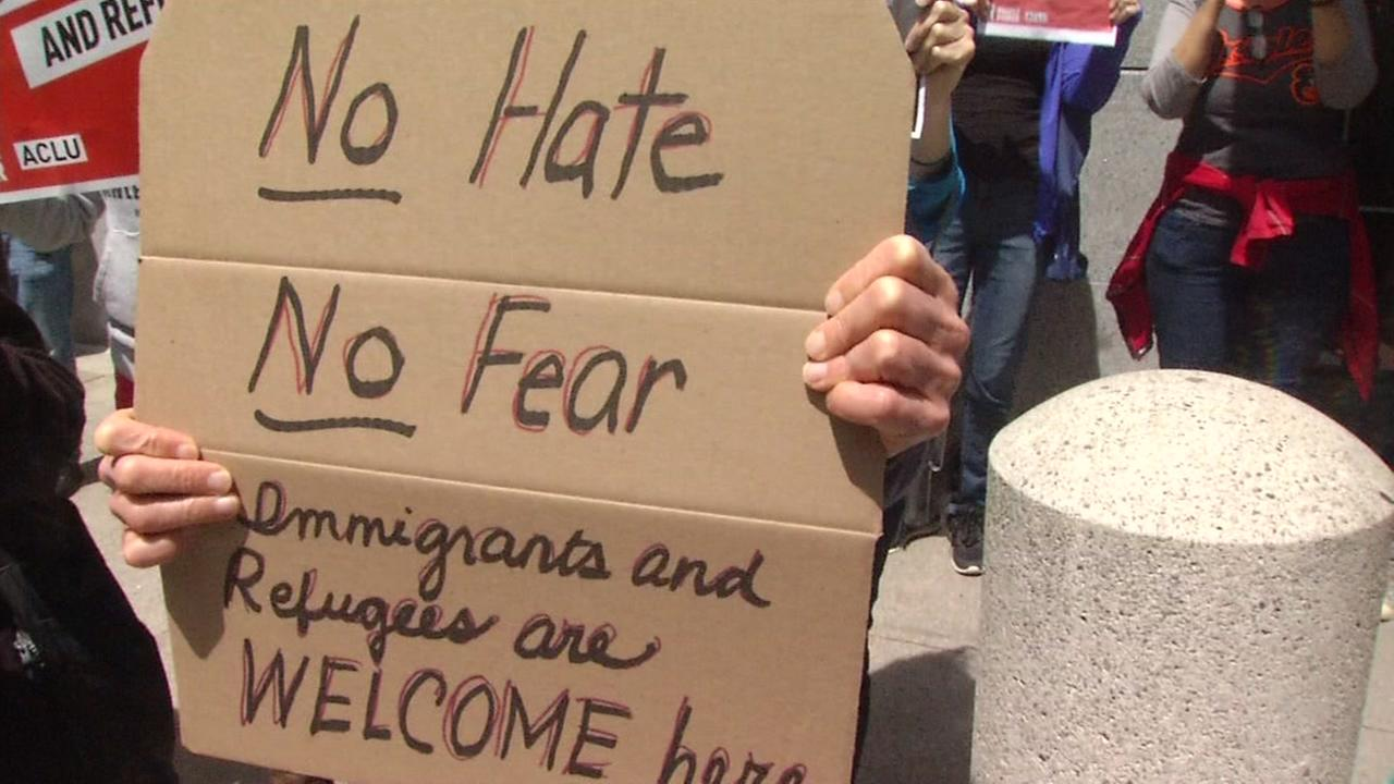 Some people in San Francisco held signs that read: No hate, no fear, immigrants and refugees are welcome here on Sunday, April 23, 2017.