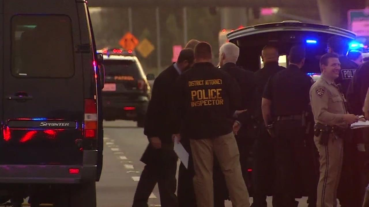 Officers are seen after a fatal freeway shooting in San Mateo, California on Friday, April 28, 2017.