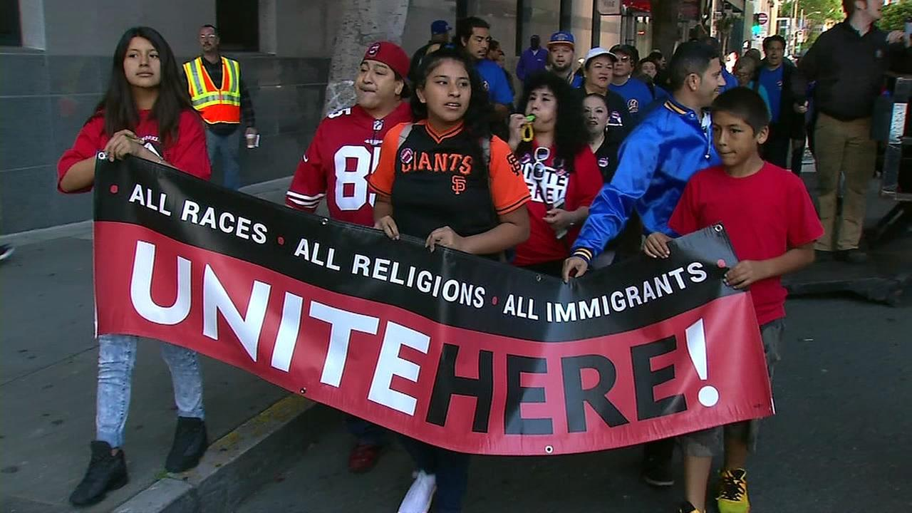 Protesters march down a street in San Francisco on Monday, May 1, 2017.