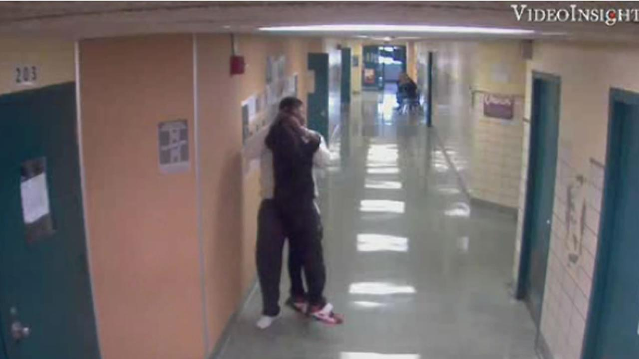 Surveillance video shows school employee lifting 13-year-old student by neck