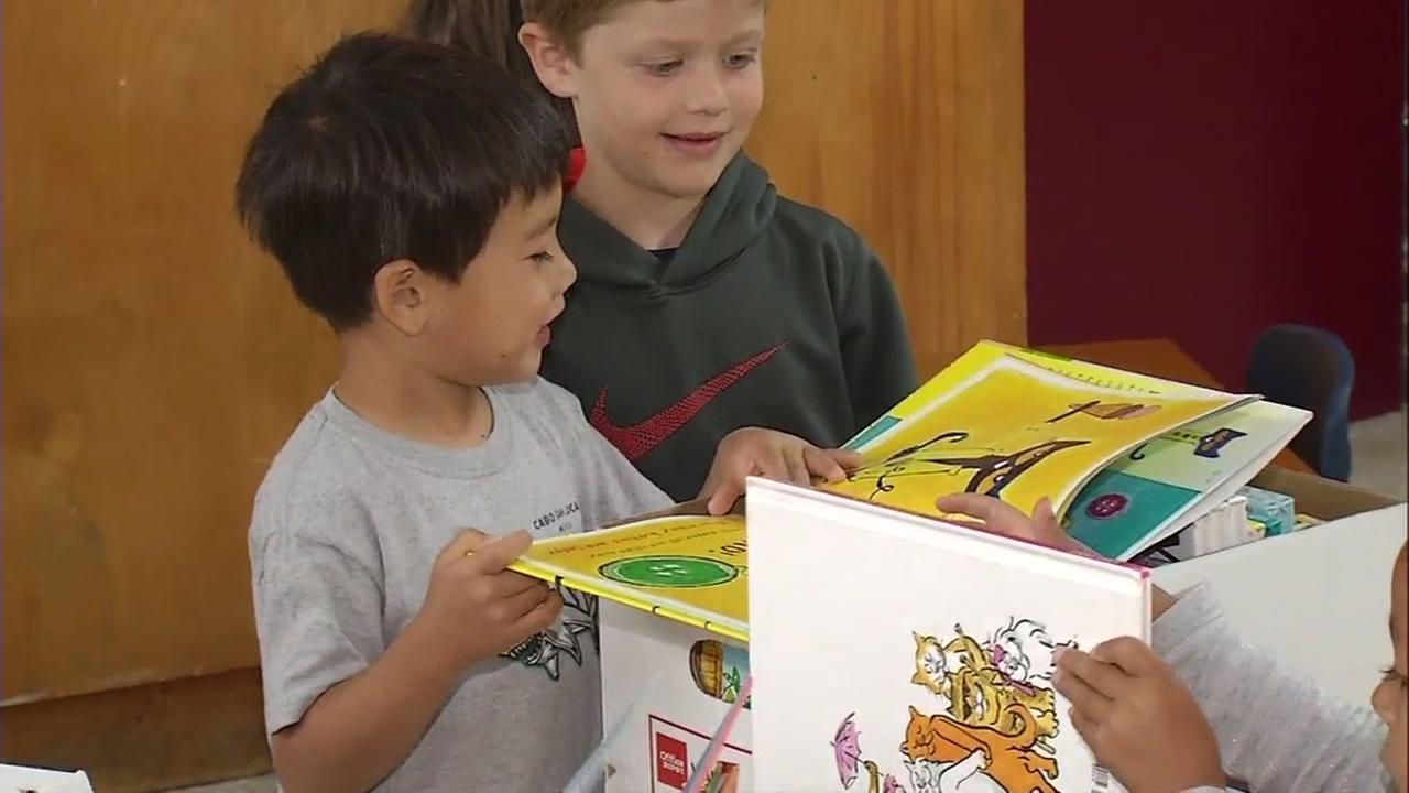 Students at Montessori School in San Jose, Calif. are seen holding books on Thursday, May 25, 2017.
